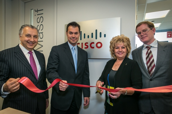 Cisco Canada's Paul Zed, Jean-Claude Ouellet and Mike Ansley with Quebec City Deputy Mayor Michelle Morin-Doyle