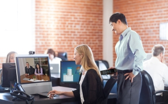 Collaborating with employees using Cisco TelePresence.