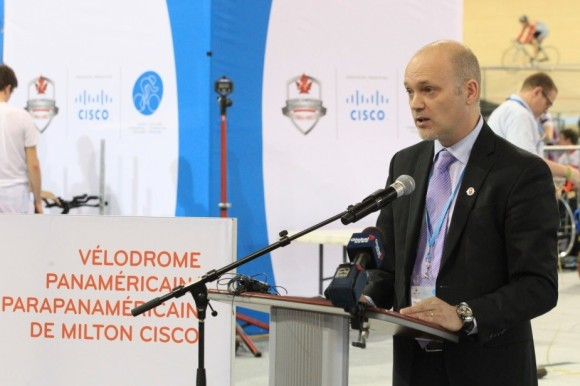 Cisco Canada's VP of marketing, Mark Collins, speaks with attendees during the Cisco Milton Pan Am/Parapan Am Velodrome opening event on January 9, 2015